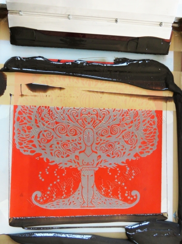 Screen printing the motif onto the lining fabric
